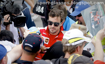 Fernando Alonso signs autographs for fans, while wearing Oakley Garage Rock Sunglasses