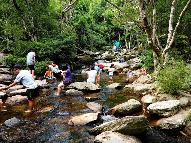 People paddling in the stream near Bride's Pool, Plover Cove Country Park, New Territories, Hong Kong