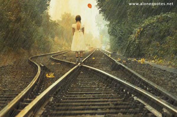 alone little girl in rain on the railway