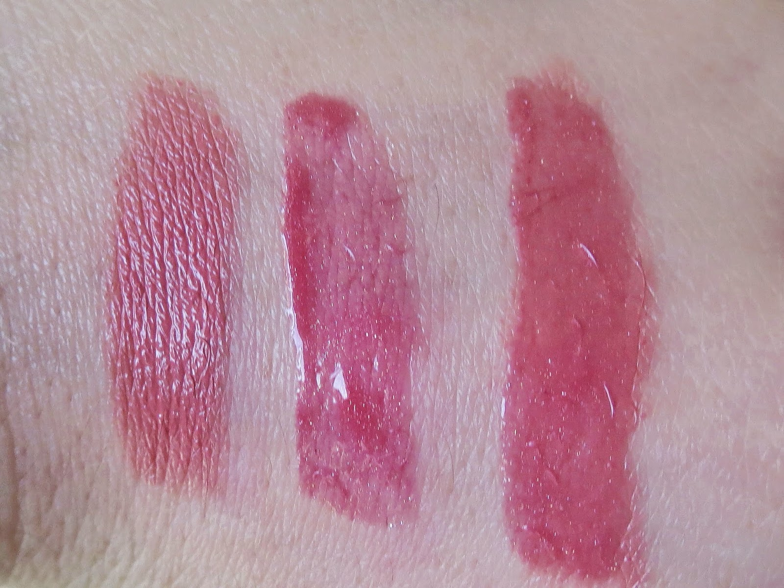 a picture of Rimmel Moisture Renew Lipstick in Let's Get Naked and Laura Mercier Lip Glace in Rose