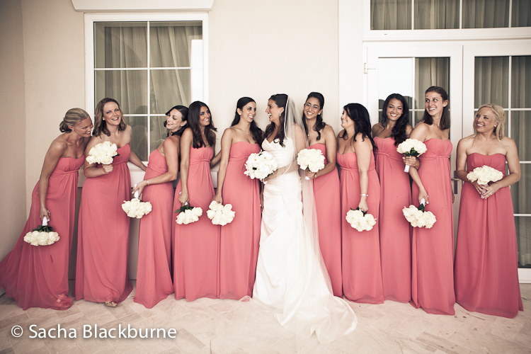 Layla chose coral navy and white for the wedding palette because coral is