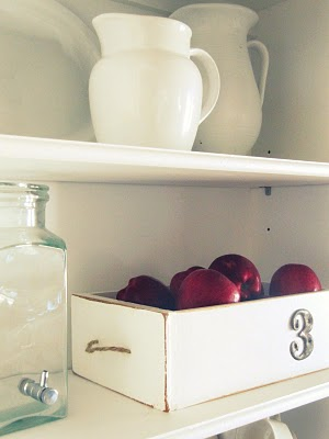 This simple white drawer adorned with a number is great for storing fresh apples.