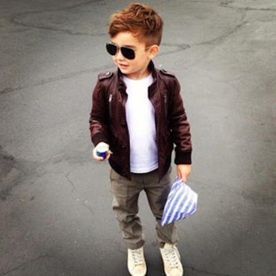Alonso Mateo stylish toddler in biker jacket and sunglasses