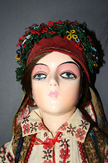 repair and restoration of antique dolls, archival materials, professional art conservator, dolls and doll clothes, Ukranian doll