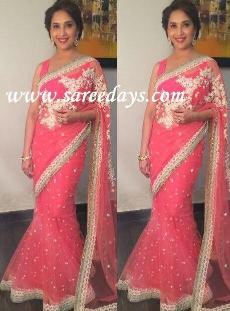 Latest saree designs madhuri dixit in dark peach netted saree madhuri dixit in dark peach netted saree altavistaventures Image collections