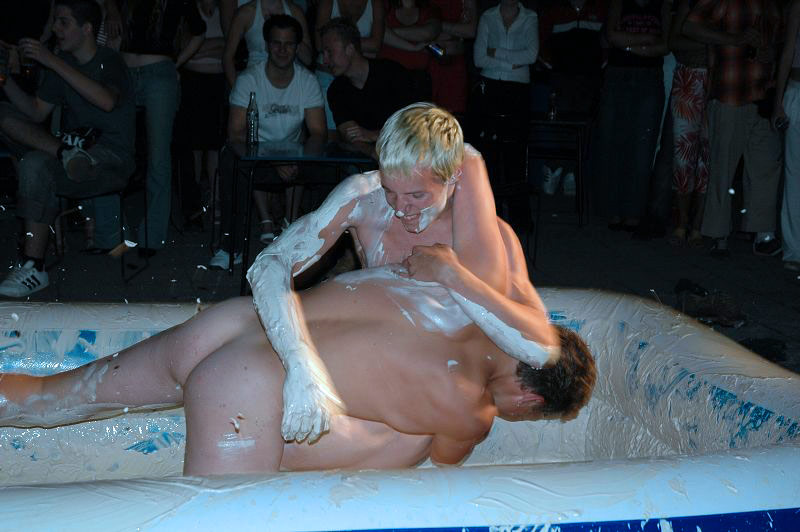 naked boy mud wrestling