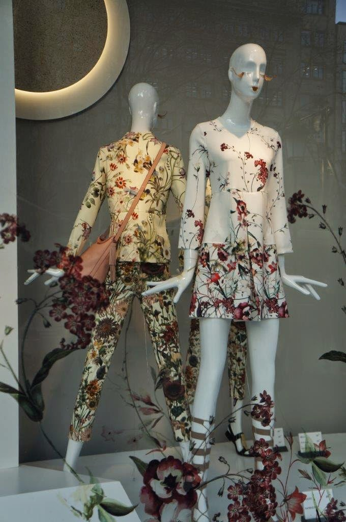 Funky floral fashion clothing in Barcelona storefront, Spain.