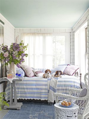 This screened in porch is a cozy hide-away with a plush daybed and some furry friends to cuddle with