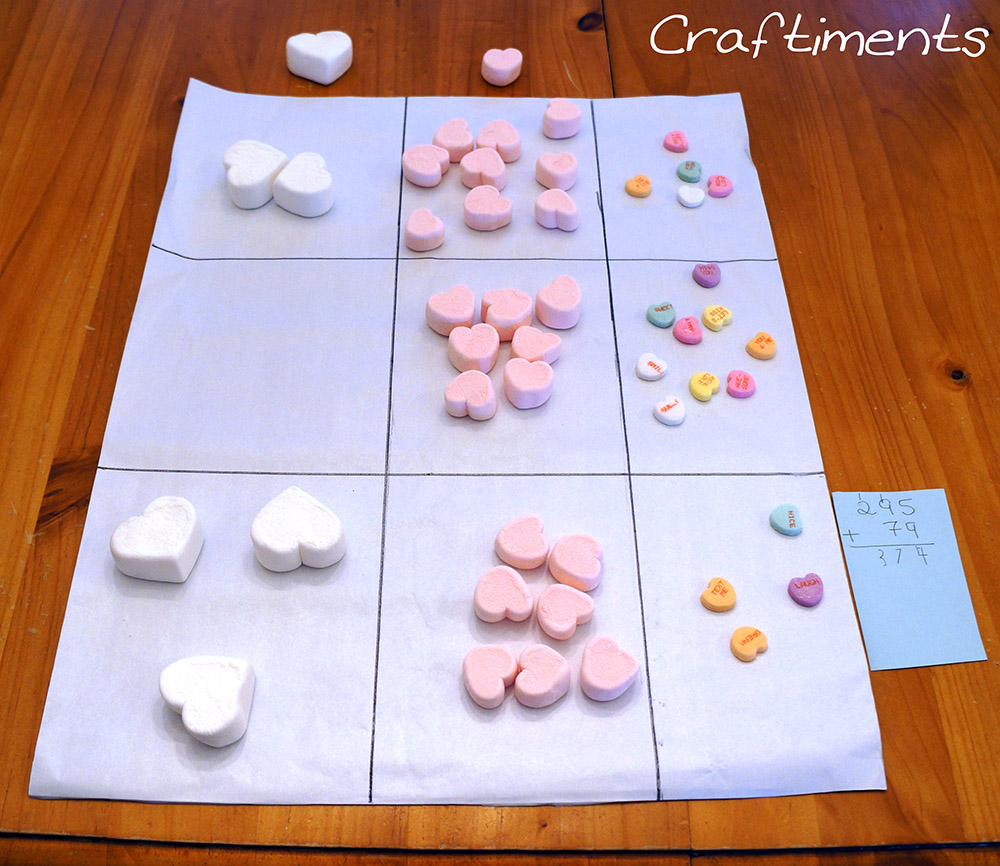 Craftiments:  Addition with regrouping using candy heart manipulatives