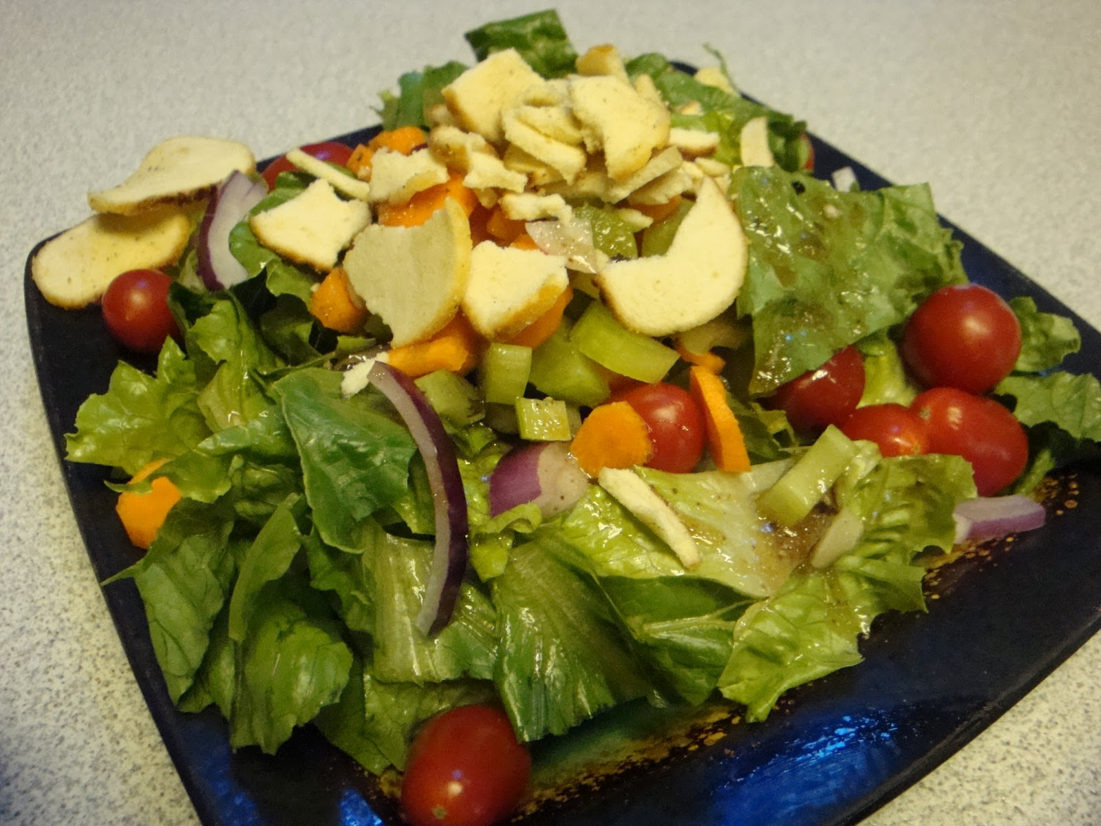 Garden salad with romaine lettuce, red onion, grape tomatoes, carrots ...