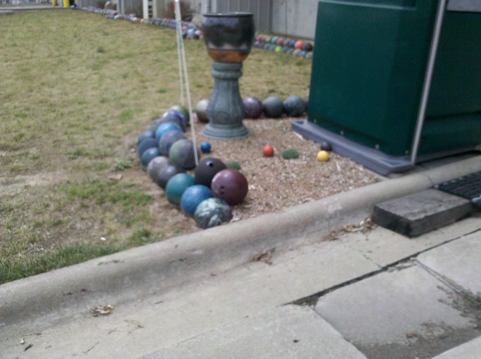 nick eddy relents bowling ball garden at dump