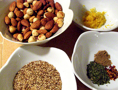 Toasted almonds and hazelnuts, toasted sesame and cumin seeds, lemon zest, coriander, mint, and red pepper