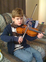 My grandson Austin playing his fiddle...