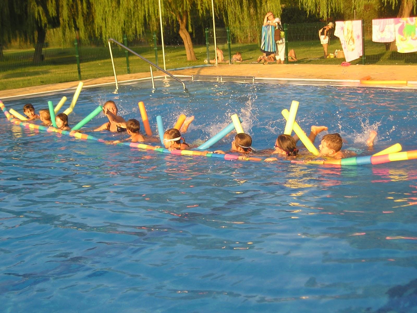 Escuela de natacion piscis fotografias verano 2011 for Piscina climatizada navalmoral