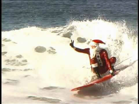 Surfing Santa Claus gets some great Christmas waves in Hermosa Beach California