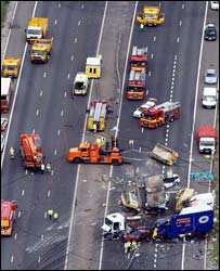 image: motorway with many cars crashed
