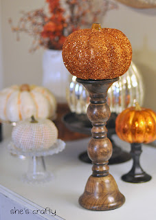 faux pumpkins covered in orange glitter as fall decoration