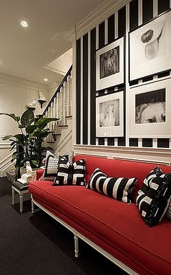 red sofa black and white pillows