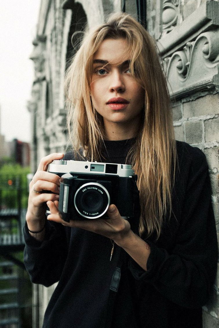 Hot girl with a camera, messy hair, babe
