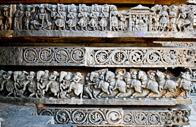 Horses on the lower row with horse riders in different poses, and the scenes of Indian epics on the upper row