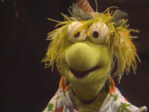 Wembley Fraggle with yellow hair and hawaiian shirt