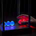 Kinetic Light Newton's Cradle delivers some light up goodness to your desk