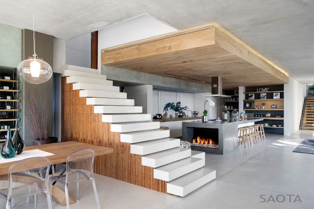 Photo of modern open kitchen by the stairs to the first floor