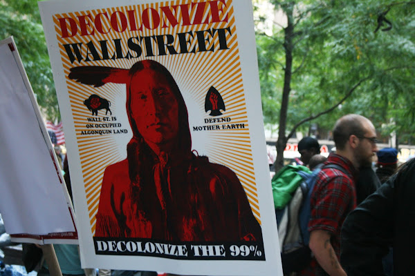 'Decolonize Wall Street' poster at Occupy Wall Street