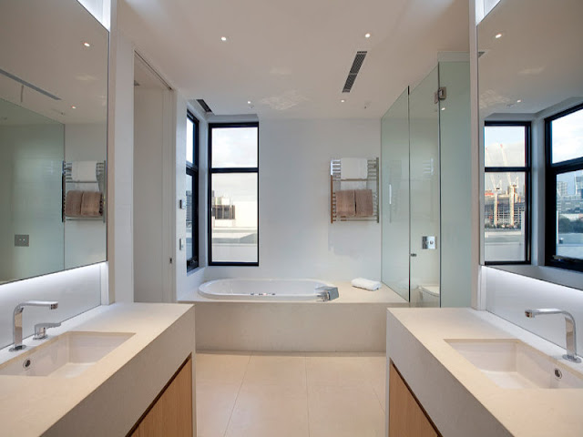 Photo of modern bathroom interiors as seen from the entrance