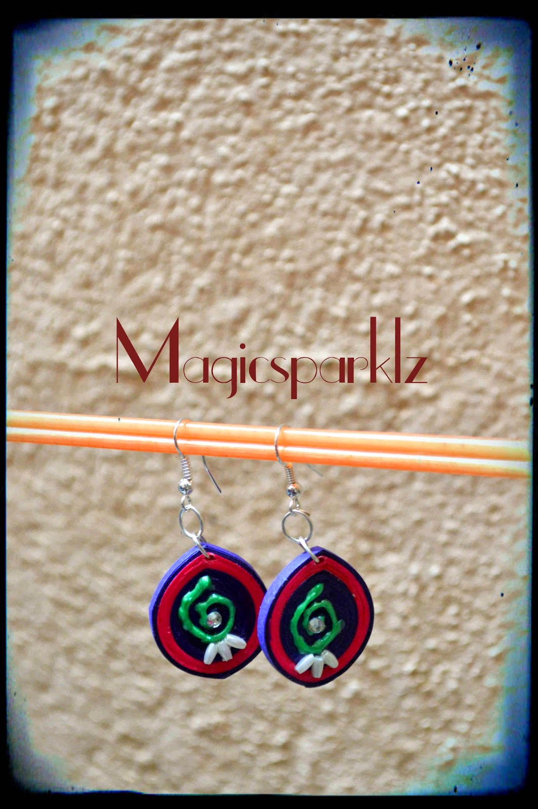 Quilled earrings with hand painted design
