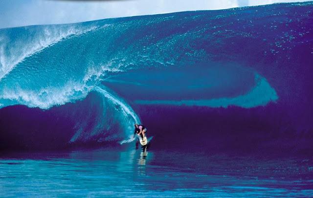 Laird hamilton surfing Teahuppo, on Tahiti