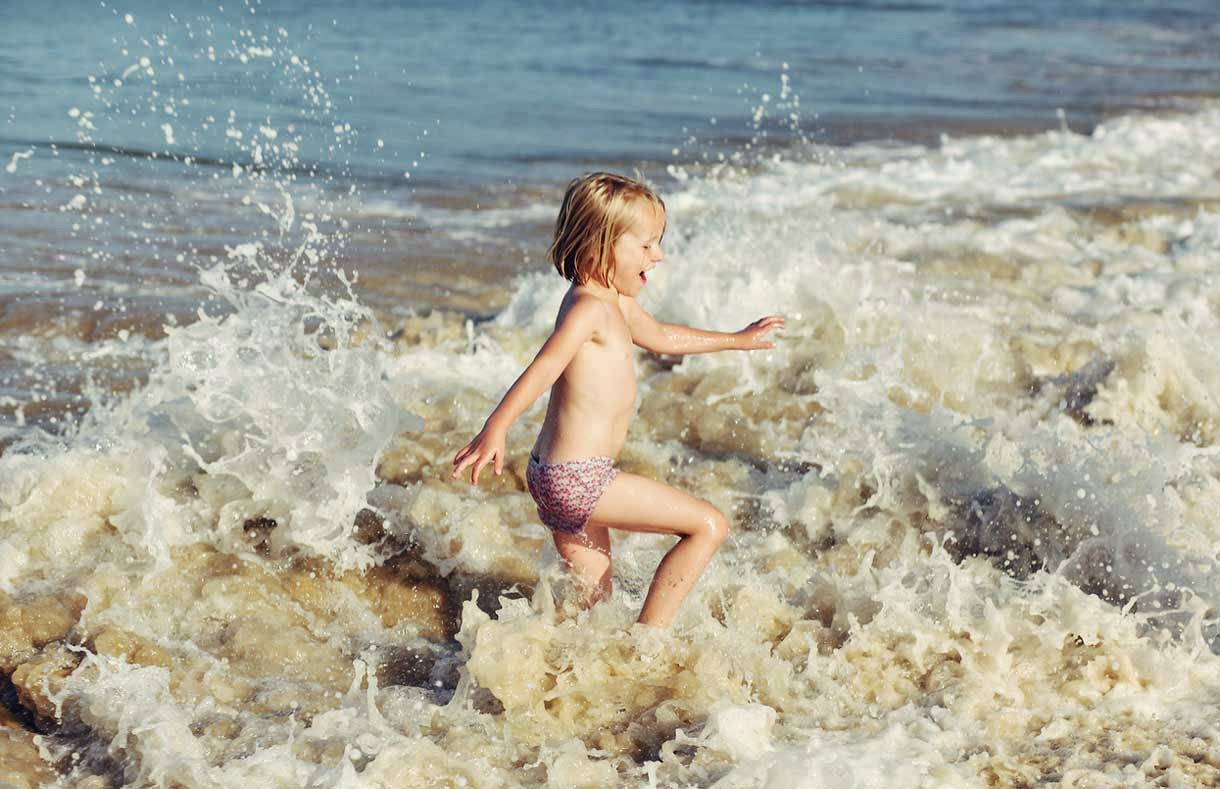 Child Playing with Sea Tide