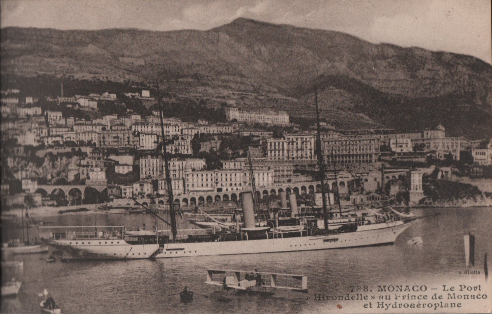 vintage postcard of the port of Monaco with hirondelle yacht and a seaplane