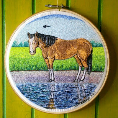horse on riverbank