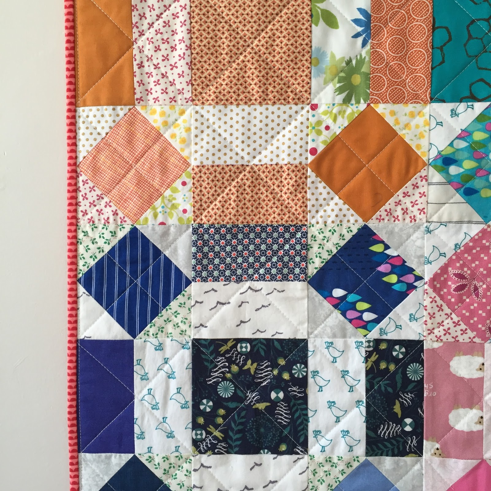 salty oat modern handmade quilts rainbow rolling stone throw quilt -  to the oversized log cabin and amish hourglass quilts i made for themaker's waypost (which opened this past saturday) i also completed asmall throw