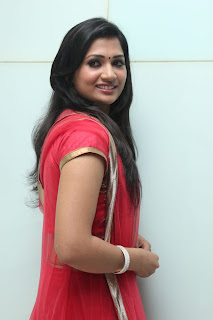 Niranjana Pics in Red Long Dress at Yasagan Audio Launch