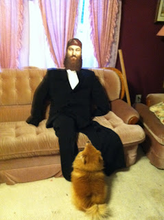 We dressed Willie in a tux and he looked so real our dog sat patiently