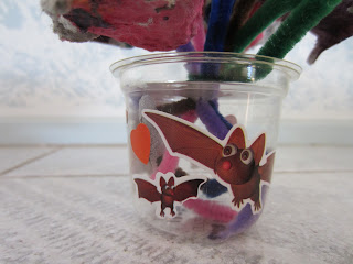 plastic pot vase decorated with stickers