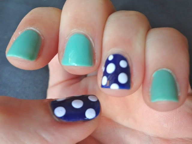 navy polka dot accent nails