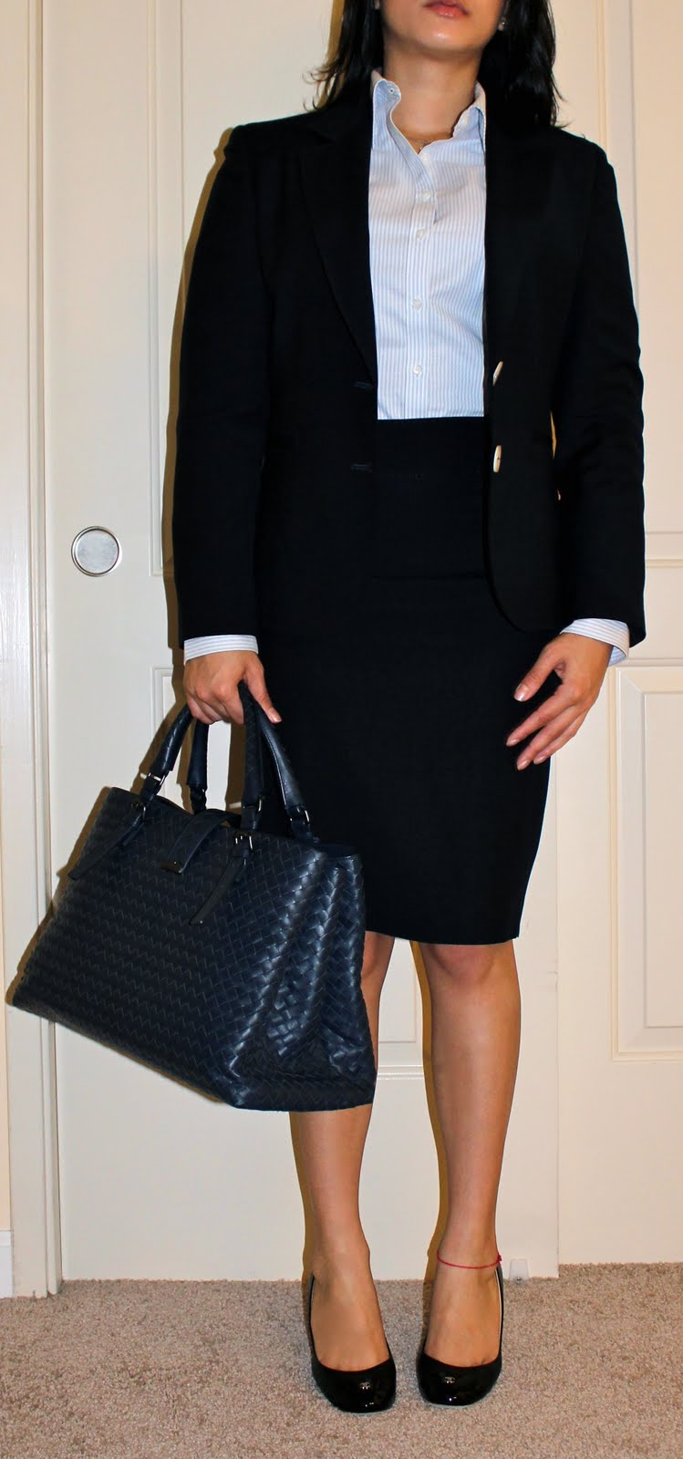interview suit guide by a petite blogger i like this purse because although it is designer it is quality out the flashy factor it also has 3 compartments which easily hide contents such as