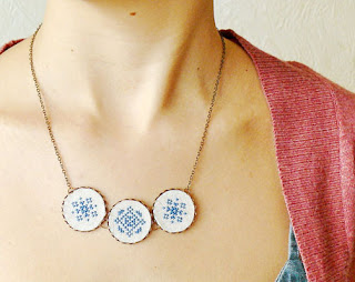 cross stitch necklace in blue and white