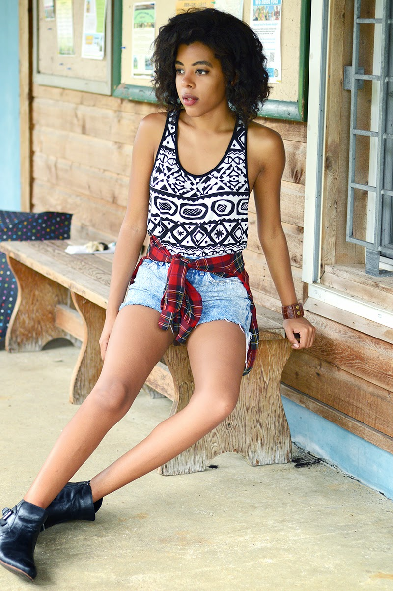 Miami Fashion Blogger Anais Alexandre of Down to Stars in an aztec print Forever 21 top with thrifted jean shorts, vintage plaid top and dolce vita rodge boots