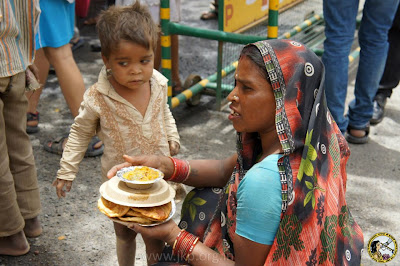 Feeding the poor at Golok Dham, Kripaluji Maharaj's ashram in Delhi