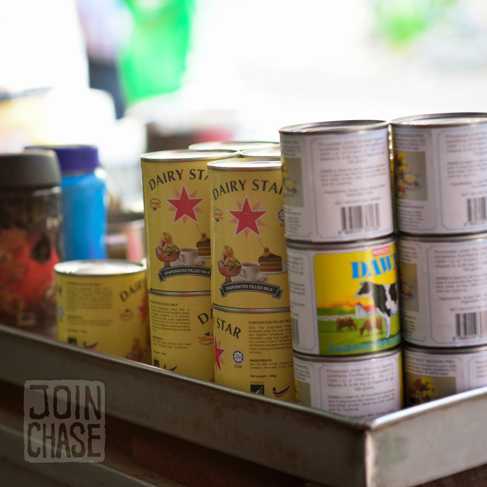 Cans of sweetened condensed milk in a teashop in Yangon, Myanmar.