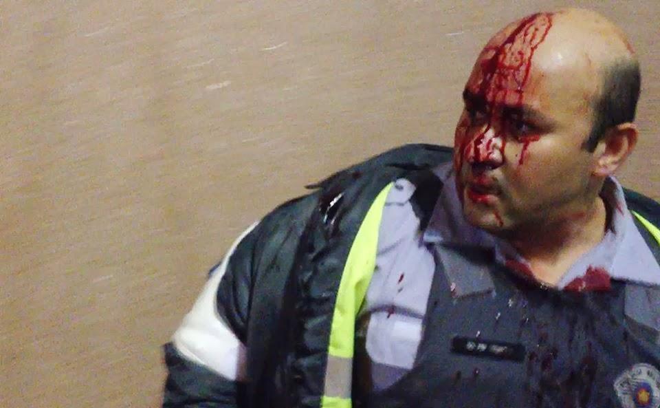 Policial agredido em manifestação - Um Asno