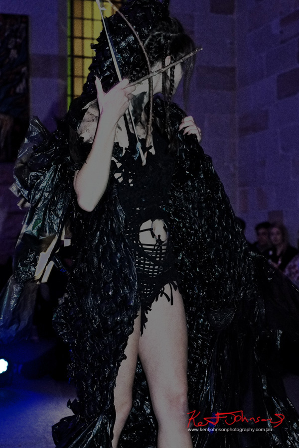 Woman models black plastic bag cape and weave body suit. Raw to Recycled by Dehautt - Photographed by Kent Johnson.