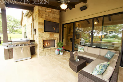 enviable outdoor livings that is complete with grills and high-end fire pit and electronic media