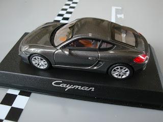 Porsche Cayman typ type 981c 2013 WAP 0200300D 1:43 dunkelgrau metallic Norev