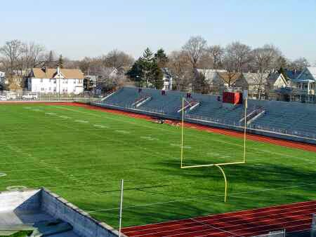 "Port Richmond H.S. football field and bleachers. The big fence we ""attempted"" to scale was right behind them."