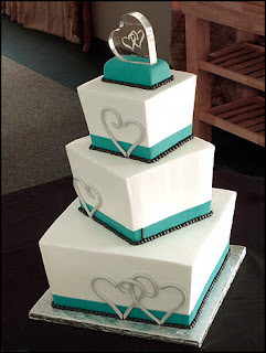 4 tier white and teal square wedding cake
